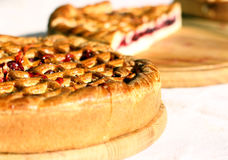 Conceptual image for  sweet baking business pies. Traditional red berry pies tart cake pastry food isolated on white background. Selective focus. Conceptual Stock Image