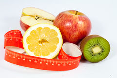 Tape measure and healthy fruit Royalty Free Stock Photography