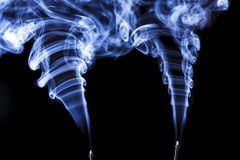 Two plumes in blue incense smoke. Royalty Free Stock Photo
