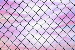 Conceptual image of twilight sky with effect of light pastel tone and steel mesh wire fence. Concept of hope and freedom royalty free stock images