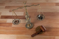Conceptual image of watch and coins on the justice scale Stock Photo