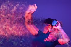 Conceptual image of woman wearing VR headset. And being blown away by the virtual reality. Blending imagination with reality Stock Photography