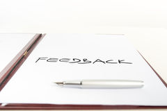 Conceptual image with the word Feedback. Piece of white paper with a Feedback sign placed in an open executive folder royalty free stock image
