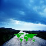 World map on the dirt road. Conceptual image of a world map on the dirt road stock photo