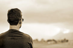 Young man looking out onto a bright new future Royalty Free Stock Photo