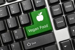 Conceptual keyboard - Vegan Food green key with apple symbol. Close-up view on conceptual keyboard - Vegan Food green key with apple symbol royalty free stock image