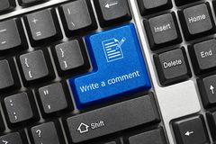 Conceptual keyboard - Write a comment blue key. Close-up view on conceptual keyboard - Write a comment blue key royalty free stock images