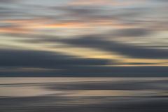Conceptual landscape image of motion blur in the ocean during su Stock Image