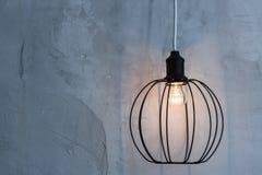 Conceptual light bulb on gray background. Horizontal. Loft interior Stock Photos