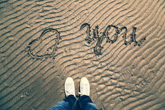 Conceptual love you with man foot background Royalty Free Stock Photography