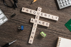 Conceptual media keywords on table with elements of game making crossword Royalty Free Stock Images