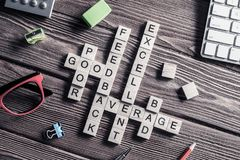 Conceptual media keywords on table with elements of game making Royalty Free Stock Photo