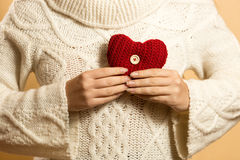 Conceptual medical photo of woman holding heart on chest Royalty Free Stock Photography