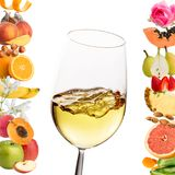 Conceptual multiple white wine aromas. Extreme close up of glass with white wine.Conceptual fruit and flower aromas around glass.Isolated on white background royalty free stock image