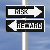 Risk and Reward. Conceptual one way road signs on Risk and Reward Stock Image