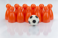 Conceptual orange game pawns Royalty Free Stock Photography