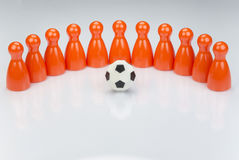 Conceptual orange game pawns Stock Images