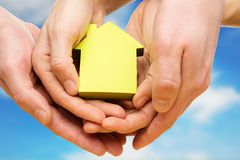 Conceptual paper house in hands Royalty Free Stock Photography