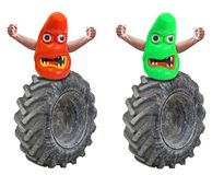 Road rage blob menace monsters riding huge tyres. Conceptual photo of a blob monsters riding giant tyres depicting road rage menace etc royalty free stock photos