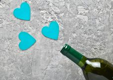 Conceptual photo Bottles of wine and pink decorative hearts. Love, romantic concept, top view.. Conceptual photo Bottles of wine and blue decorative hearts stock photography