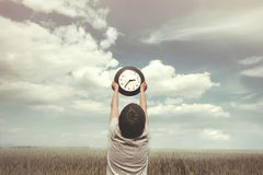 Conceptual photo of little boy and the relativity of time. Conceptual photo of a boy and the relativity of time stock image