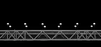 Conceptual photo of bridge with lamps in dark background royalty free stock image