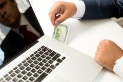 Conceptual photo of businessman receiving digital money transfer Stock Photo