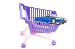 Conceptual photo with car and shopping-cart Royalty Free Stock Images