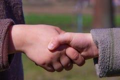 Baby boys handshake relationship conceptual photo stock image