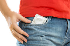Conceptual photo of condom in jeans pocket Royalty Free Stock Photography
