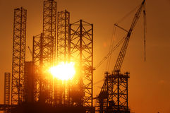 Conceptual photo of construction facilities against bright rising sun Royalty Free Stock Image