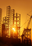 Conceptual photo of construction facilities against bright rising sun Royalty Free Stock Photography