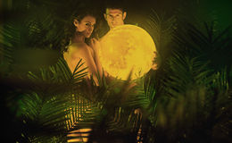 Conceptual photo of the couple carrying the moon Stock Photos