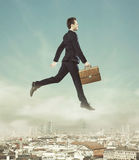 Conceptual photo of flying businessman Stock Photos