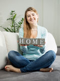 Conceptual photo of girl holding word Stock Photography
