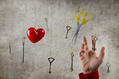 Conceptual photo hand stretching for one of the many old vintage Royalty Free Stock Images