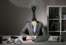 Conceptual photo illustrating burnout syndrome at work. In office royalty free stock photography