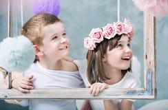 Conceptual photo of kids holdng a photo frame stock photos