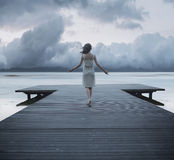 Conceptual photo of the lady on the jetty Royalty Free Stock Photography