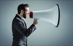 Conceptual photo of man yelling over the megaphone Stock Images
