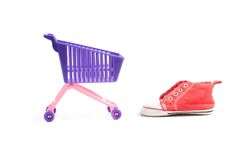 Conceptual photo with miniature shopping-cart Royalty Free Stock Photo
