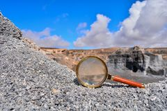 Object in the Dry Desert. Conceptual Photo Picture of a Loupe Object in the Dry Desert Royalty Free Stock Image