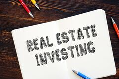 Conceptual photo about Real Estate Investing with written phrase