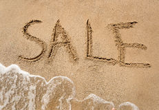Conceptual photo of summer sale written on sandy beach Royalty Free Stock Images