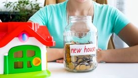 Conceptual photo of taking bank loan for buying new house. Conceptual image of taking bank loan for buying new house royalty free stock image