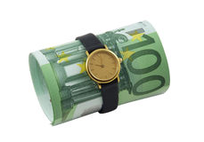 Conceptual photo - time is money. Time is money. Watch and one hundred euro banknotes isolated over white Royalty Free Stock Image