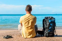 Conceptual photo - tourist on vacation. By the sea Royalty Free Stock Photo