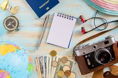 Travel concept photo on blue wooden background priparation for travelling stock photography