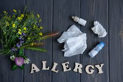 Conceptual photo with wildflowers, nose drops and shawls. Allergy. Allergy drops. Seasonal allergy to flower pollen. Conceptual photo with wildflowers, nose stock photography