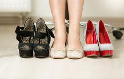 Conceptual photo of woman choosing most comfortable shoes Royalty Free Stock Image